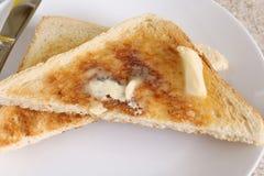 Pane tostato e burro Fotografie Stock Libere da Diritti