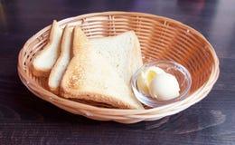 Pane tostato e burro Immagine Stock