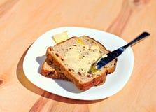 Pane tostato e burro dell'uva passa Immagine Stock Libera da Diritti