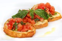 Pane tostato francese con i pomodori Fotografia Stock Libera da Diritti