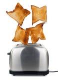 Pane tostato schioccando da un tostapane immagine stock libera da diritti