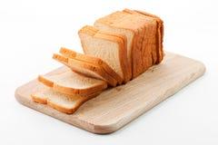 Pane tostato sulla scheda di taglio Immagine Stock Libera da Diritti
