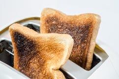Pane tostato in un tostapane Fotografia Stock Libera da Diritti