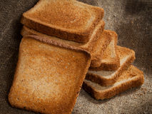 Pane tostato in una pila Fotografie Stock Libere da Diritti