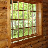 Pane Window. In a log wall in Upper Michigan Royalty Free Stock Photography