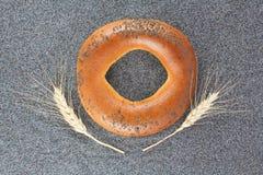 Panecillo con la amapola Imagenes de archivo