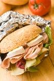 Panecillo delicioso del jamón y del queso Imagen de archivo