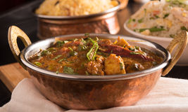 Paneer Butter Masala in a brass bowl. Stock Image
