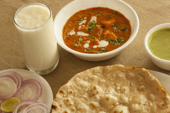 Paneer butter masala with tandoori roti and sweet lassi Royalty Free Stock Photos