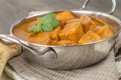 Paneer Makhani or Shahi Paneer. (Paneer Butter Masala) - Indian curd cheese curry in a balti dish, served with naan bread and garnished with coriander leaves Stock Photo