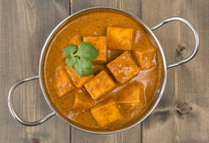 Paneer Makhani or Shahi Paneer. (Paneer Butter Masala) - Indian curd cheese curry served in a balti dish and garnished with coriander leaves. Shot from above ( Royalty Free Stock Image