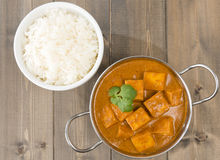 Paneer Makhani or Shahi Paneer. (Paneer Butter Masala) - Indian curd cheese curry served in a balti dish served with rice and garnished with coriander leaves Royalty Free Stock Photos