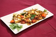 Paneer tikka. Paneer is a cheese with mild milky flavor, Paneer tikka is a delicious dish.The ingredients are lemon, cumin, garam masala a spice mixture used in royalty free stock image