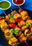 Paneer tikka kebabs served with sauce and mint chutney. As a party appetizer Royalty Free Stock Images