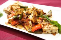 Paneer tikka. Paneer is a cheese with mild milky flavor, Paneer tikka is a delicious dish.The ingredients are lemon, cumin, garam masala a spice mixture used in royalty free stock photos