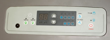 Panel. Grey control  panel  on conditioner Royalty Free Stock Photo