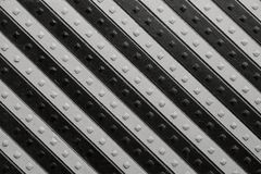 Panel with  black gray slanting striped pattern. Fragment of the ancient riveted panel from the painted wooden boards with black gray slanting striped pattern Royalty Free Stock Photography