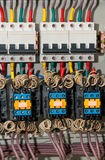 Panel with circuit breakers and actuators Stock Photos