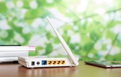 Panel for connecting broadband wireless LAN, near smartphone on table. Panel for connecting broadband wireless LAN, near smartphone on wooden table royalty free stock images