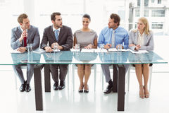 Panel of corporate personnel officers in office. Panel of corporate personnel officers sitting at table in office Stock Images
