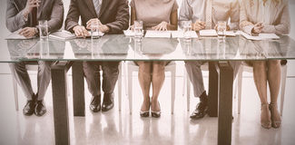Panel of corporate personnel officers in office. Panel of corporate personnel officers sitting at table in office royalty free stock photography