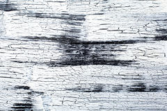 Panel with cracked paint, black and white craquelure, artificial Stock Images