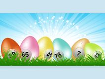 Easter bingo lottery eggs panel on grass Royalty Free Stock Image