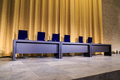 Panel desk. Desk with chairs and microphones, for press conference or panel discussion Royalty Free Stock Images