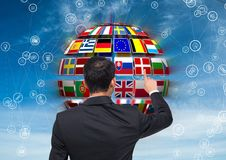 Panel with flags on a ball and business man doing something on it Royalty Free Stock Photo