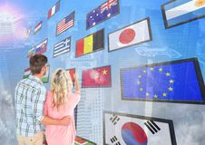 panel with flags, city background. Couple fingering one flag Stock Image