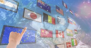 panel with flags, earth eye background and hand fingering one flag Stock Image