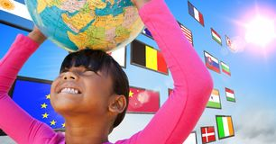 panel with flags in the sky. Girl having fun with earth ball Stock Photo