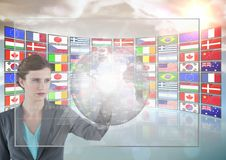 Panel with flags woman doing things in a futuristic tactile screen Royalty Free Stock Photo