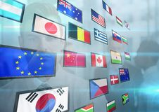 Panel with flags and young business man back Royalty Free Stock Image