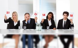 Panel judges holding bad score signs Stock Image