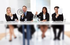 Panel judges holding empty score signs Royalty Free Stock Images