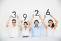 Panel judges holding score signs Stock Image