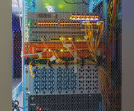Panel modern communications equipment behind bars the door chassis with the display in the data center Royalty Free Stock Photos