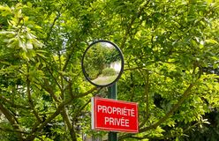 Panel of private property and mirror of bend Royalty Free Stock Images