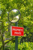 Panel private property and mirror of bend Stock Photos