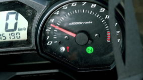 Panel of sports bike in the process of starting the engine. stock footage