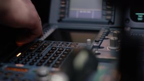 Panel of switches on an aircraft flight deck. Autopilot control element of an airliner. Pilot controls the aircraft. Onboard computer, cockpit 4K stock footage