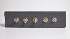 Panel of toggle switches Stock Photography