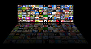 Panel of TV's showing movies Royalty Free Stock Photos