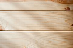 Panel of wooden planks with rays of light falling on it stock images