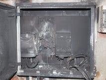 Panelboard beschädigte durch Anstieg Stockbilder