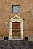 Panelled old wood door in solid stone surround Royalty Free Stock Images