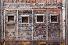 Panelled wooden window frame of bare wood. Stock Photo