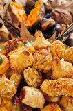 Panellets typical of Catalonia and roasted chestnuts and sweet p Royalty Free Stock Images