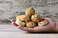 Panellets, typical confection of Catalonia, Spain. Closeup of some panellets, typical confection eaten in All Saints Day in Catalonia, Spain, on the hand of a Royalty Free Stock Photography